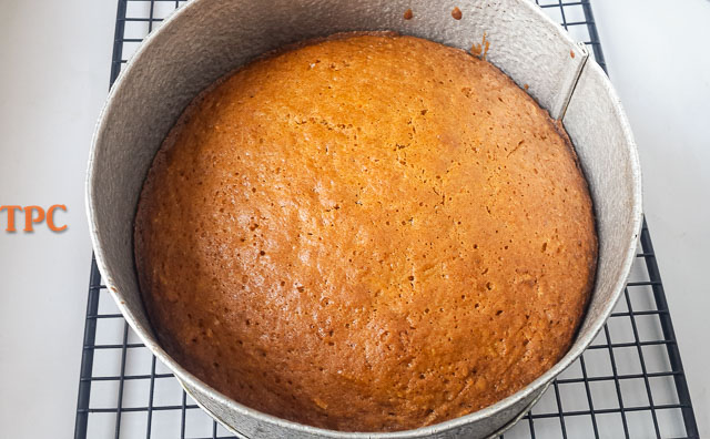 moist carrot cake in a cake pan, looking delish