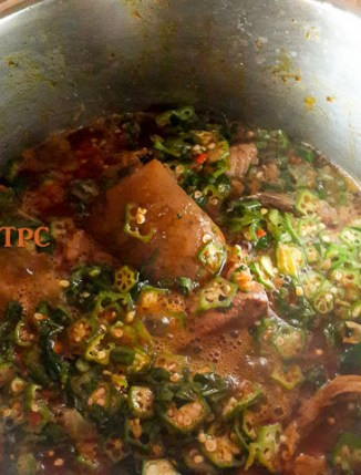 okro soup, okra soup cooking in a pot