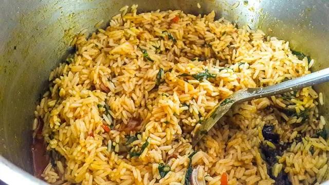 Nigerian palm oil jollof rice in a pot