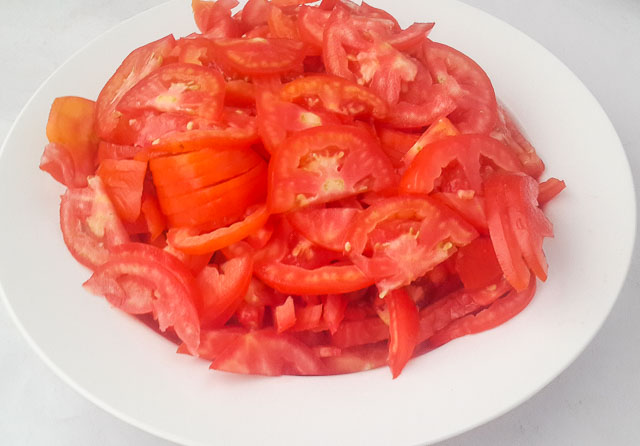 sliced tomatoes for Nigerian Coconut Rice