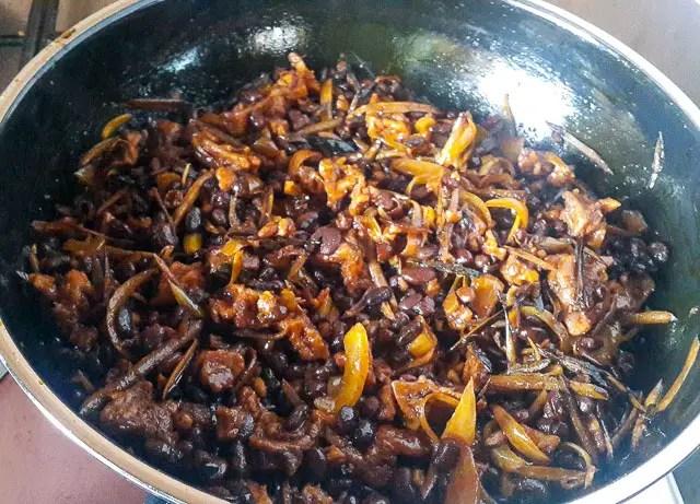 achicha, dry cocoyam in a saucepan