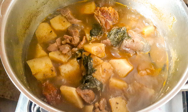 yam pepper soup boiling in a pot