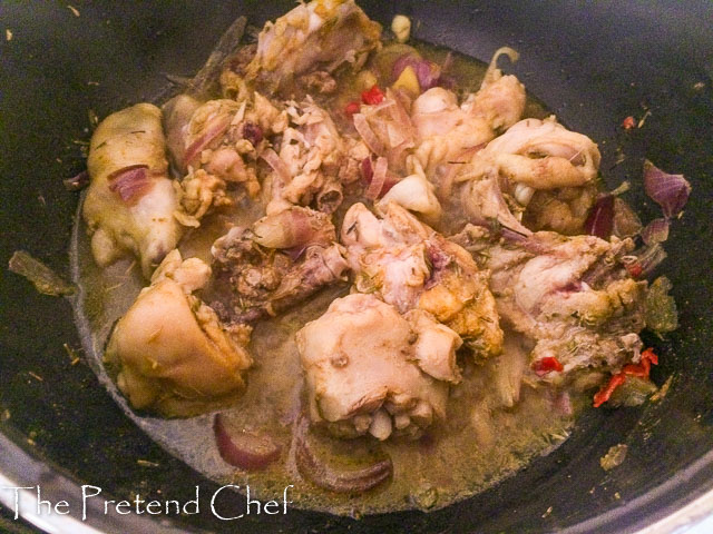 chicken spiced and cooking in a pot for Easy Nigerian vegetable sauce