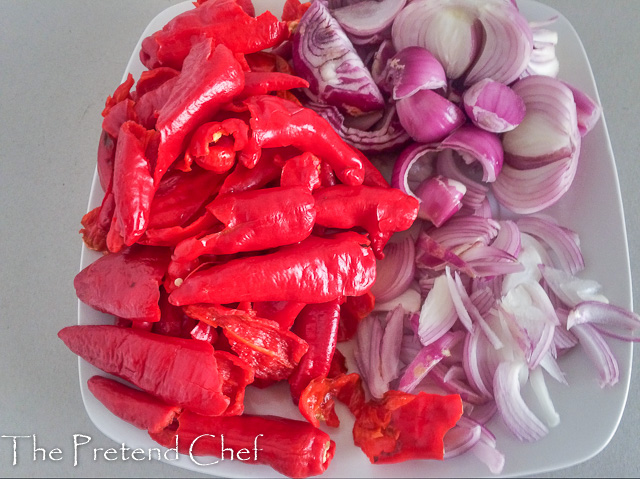peppers and onions prepared for Spicy Cayenne Pepper Stew (Shombo Stew)