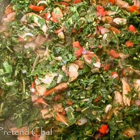 smoked fish with greens in a saucepan