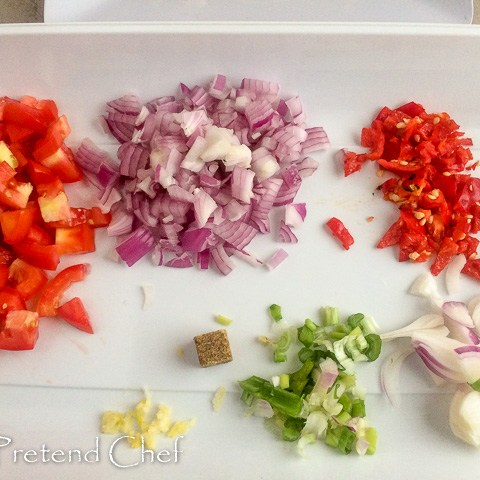 chopped vegetables in a tray for smoked fish with greens