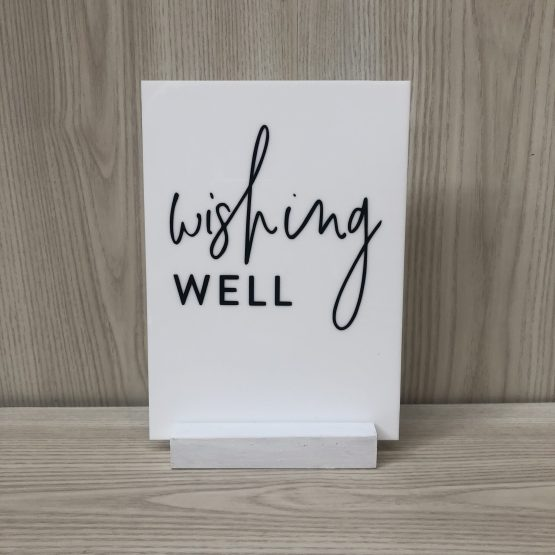 white wishing well signage