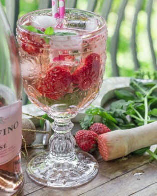 Bubbly Berry Basil Beverage - This Bubbly Berry Basil Beverage has juicy June berries and basil with a delicious rose bubble. Perfect for a patio refreshment, wine Wednesday, champagne brunch... or just because! http://www.theprimaldesire.com/bubbly-berry-basil-beverage
