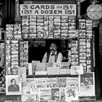 "A postcard stand on New Orleans' Royal Street also sales a newspapers and magazines, including the July 1908 number of ""The Argosy"" (bottom left)."