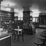 """Argosy All–Story Weekly,"" ""The Blue Book"" and the May 20, 1922, number of ""The Popular Magazine"" are among the magazines on display at left in this photo of a drugstore."