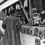Another man talks to a vendor at a newsstand in Burbank, Calif., in early 1941. Pulps dated February 1941 are on display.