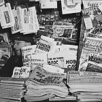 From January 1943, a newsstand on Fourth Avenue at 14th Street, New York, specializes in foreign newspapers, but also includes a few sports and detective pulps in the background.