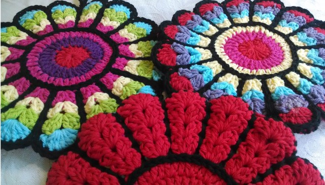 Flower potholders - multi-colored fronts with solid red backs.