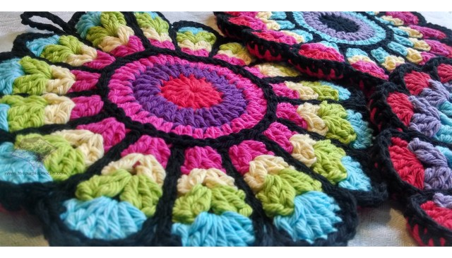 Flower potholders - multi-colored fronts with solid red backs. My favorite :)