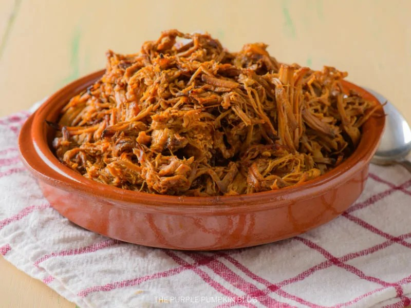 Terracotta dish filled with Hawaiian pulled pork