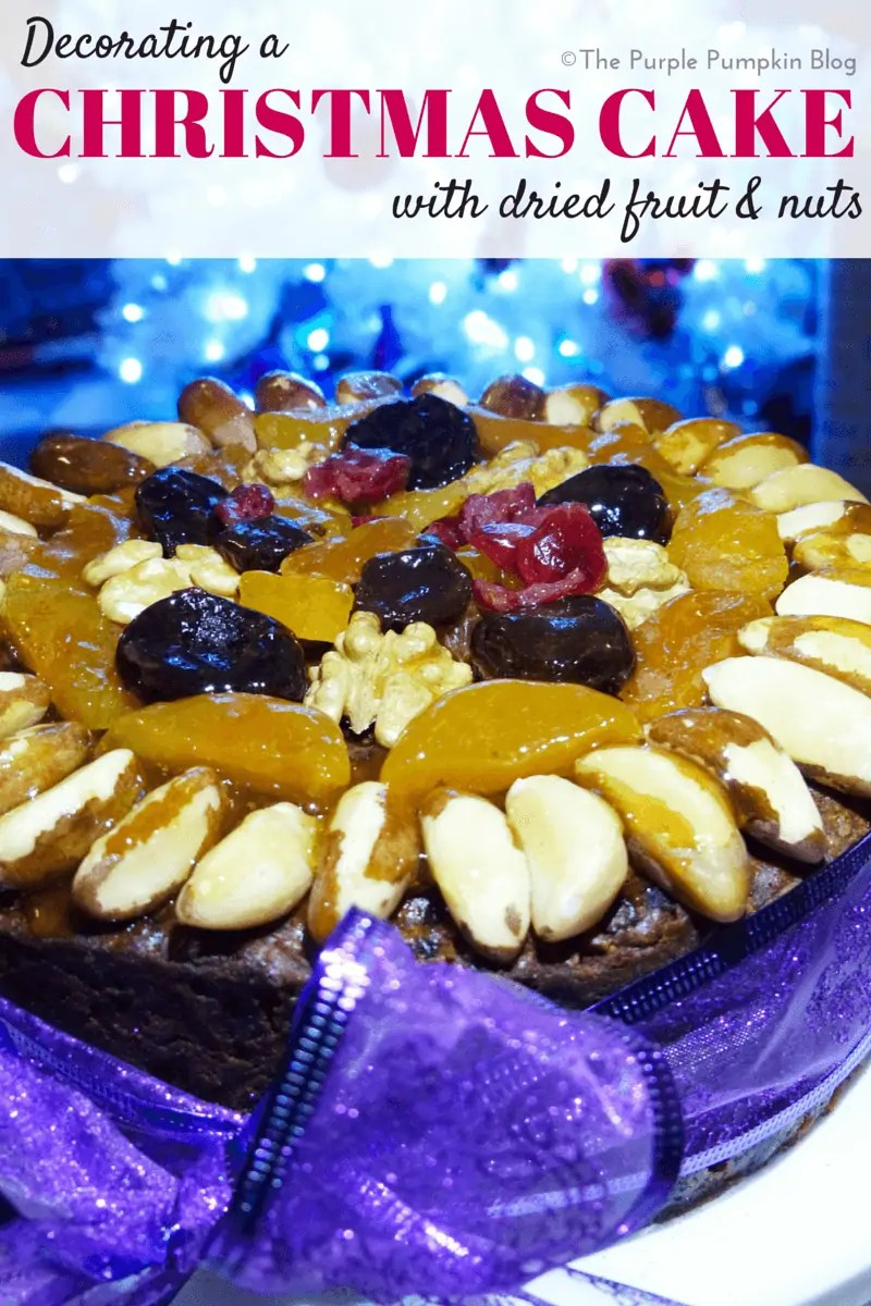 Decorating A Christmas Cake With Dried Fruit and Nuts