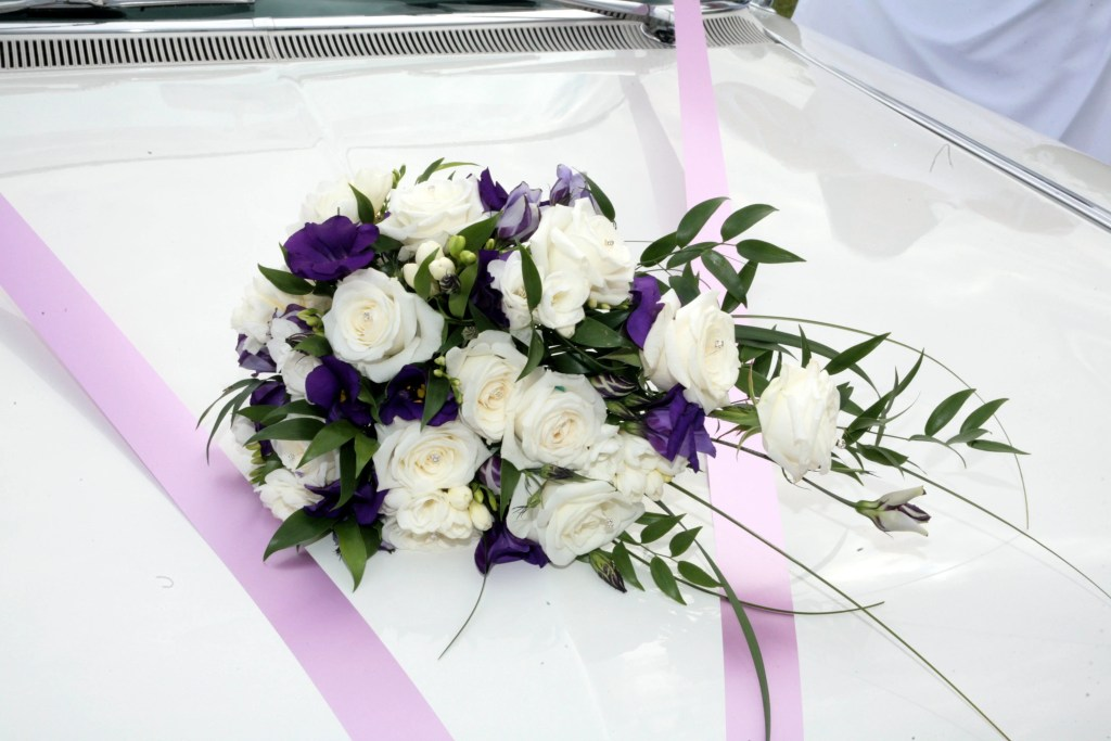Wedding bouquet with freesias, lisianthus and white roses