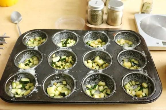 Cheesy Courgette Crustless Mini Quiche - courgettes in muffin tin