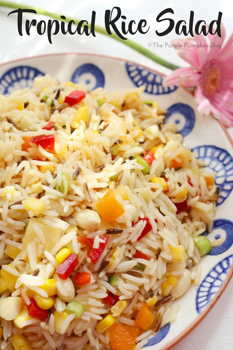 Tropical Rice Salad. This salad is a colourful mix of different flavours and textures, made with ingredients like wild rice, peppers, mangoes, and macadamia nuts. It is a tasty salad to eat on its own, or as a side to barbecued meat and fish. Also great to take to a potluck or on a summer picnic.