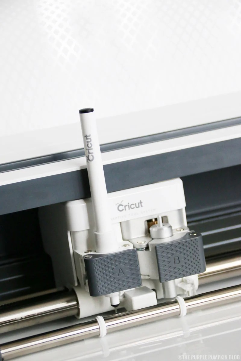 Cricut Maker with pen in clamp