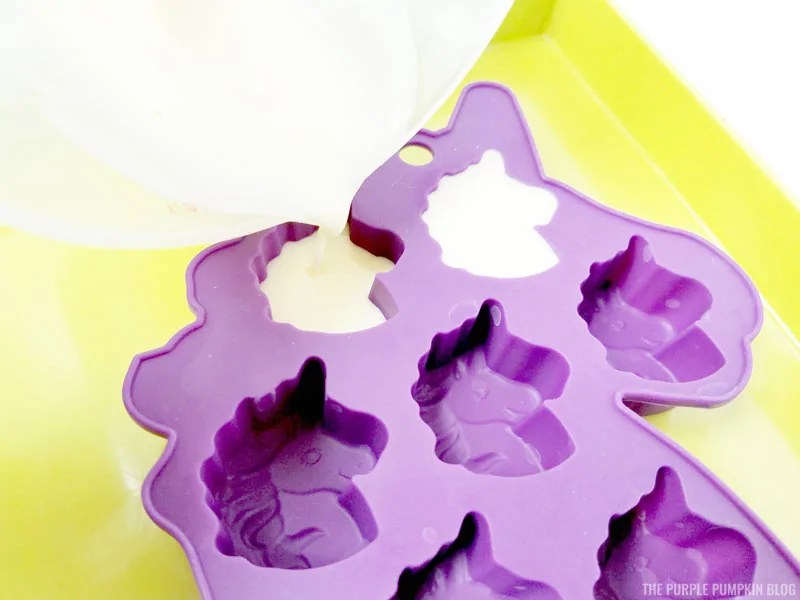 Pouring melted soap into unicorn molds