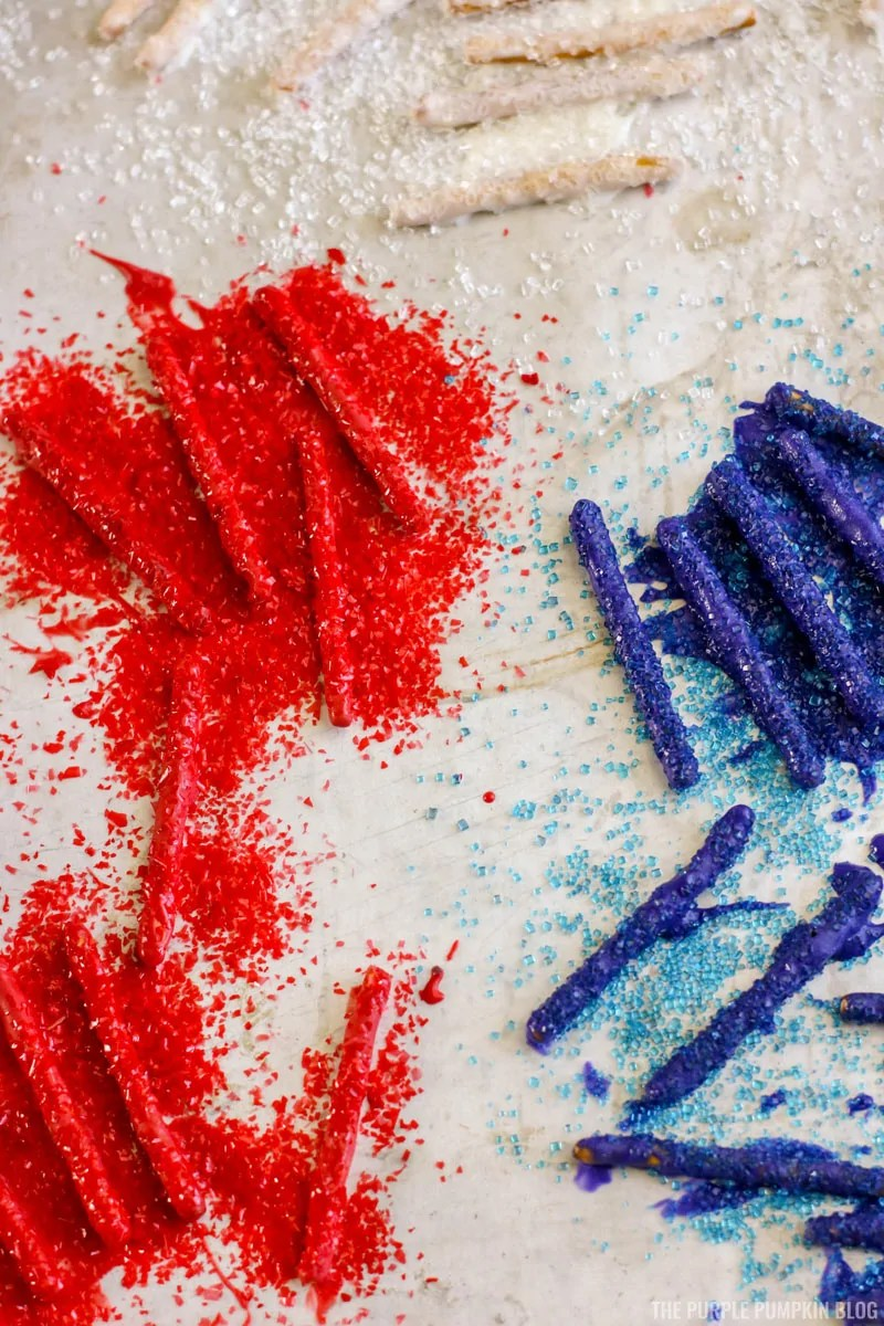 Candy covered pretzel sticks with sugar sprinkles