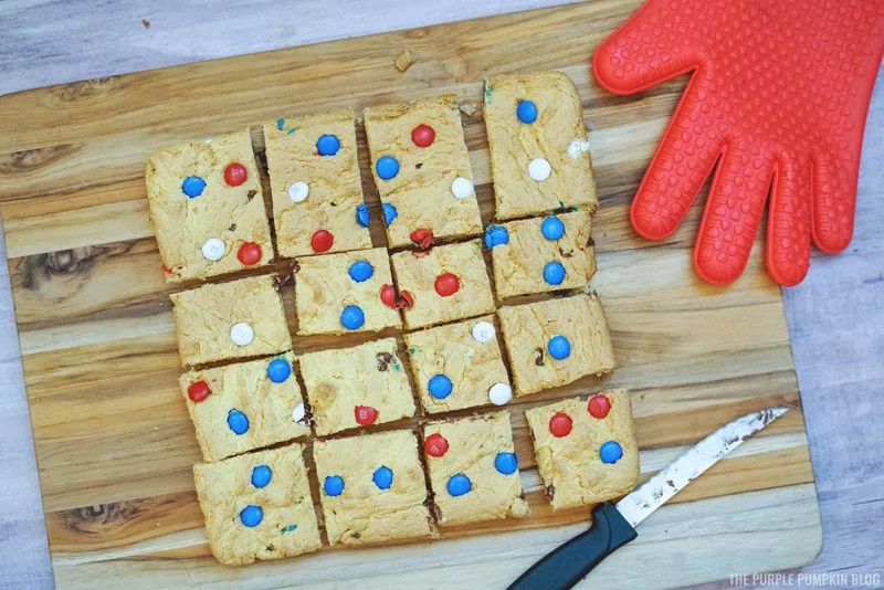 Cut cookie bars on wooden board
