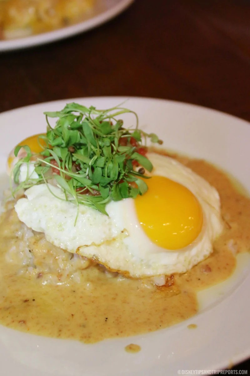 A white dish with Hawaiian breakfast Loco Moco.