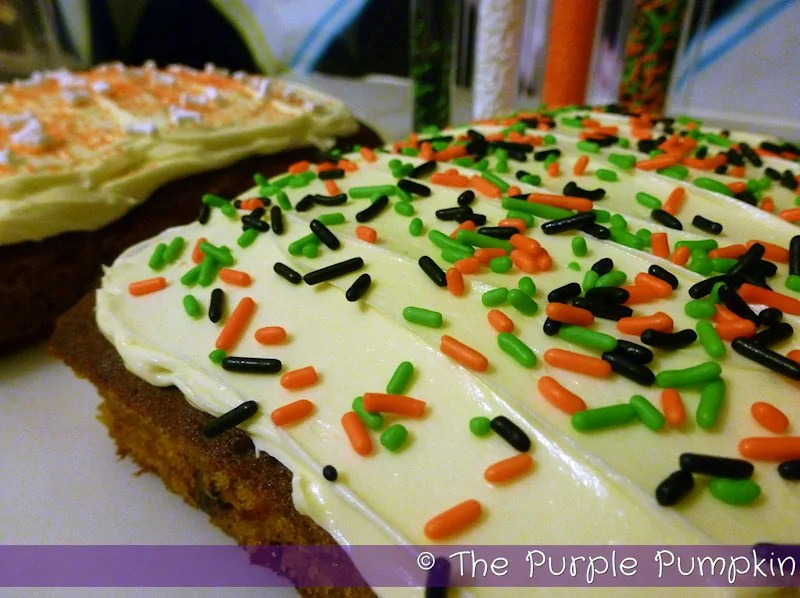 Halloween Pumpkin Cake with orange green and black jimmies sprinkles