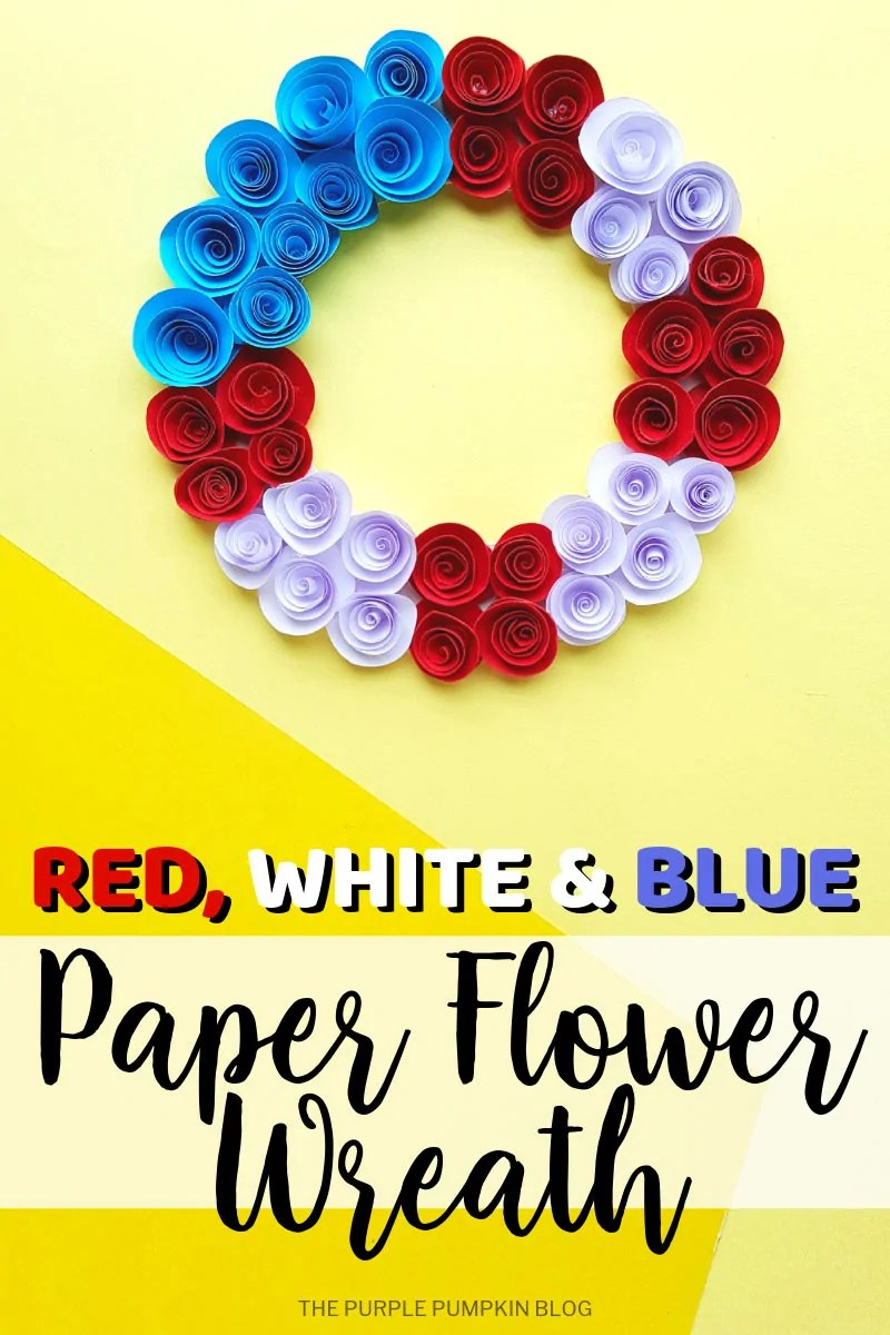 A paper flower wreath, with red, white and blue paper roses on a yellow background