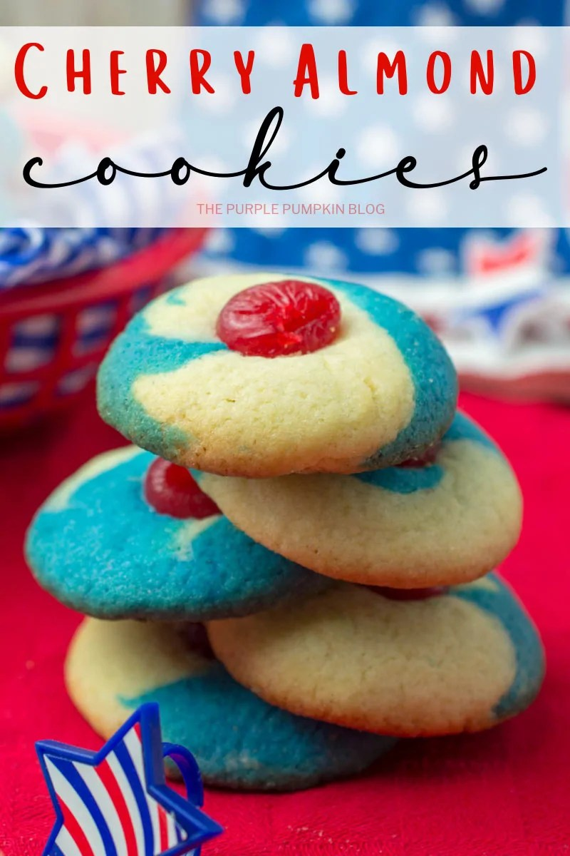 A stack of red, white, and blue cherry almond cookies on a red tablecloth
