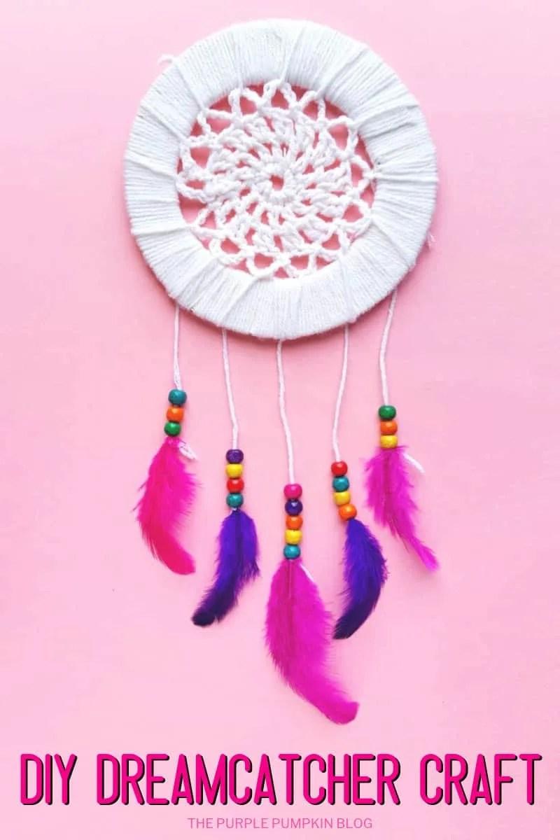 DIY Dreamcatcher Craft - a homemade dreamcatcher on a pink background