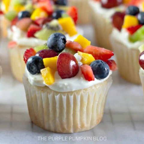 Cupcakes topped with fresh fruit salad