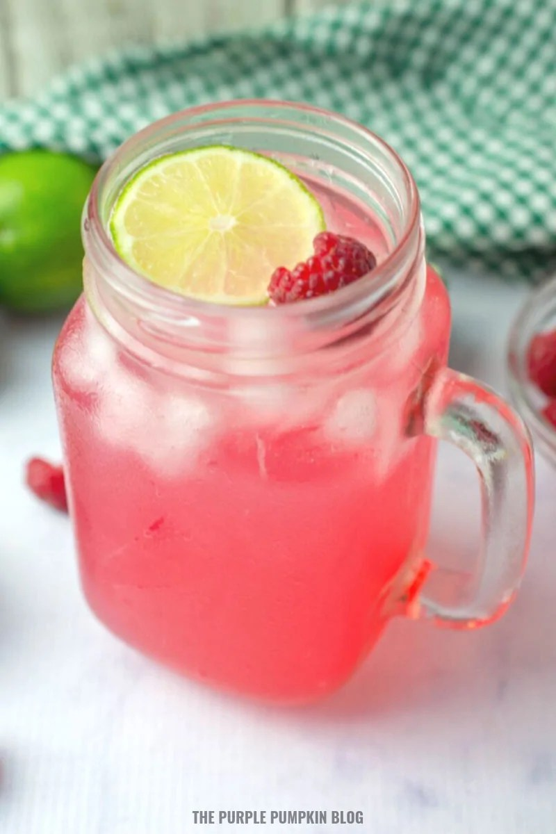 Glass of raspberry lime vodka cocktail
