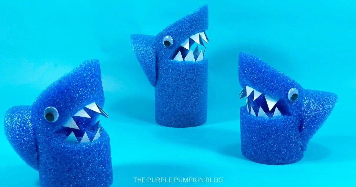 3 pool noodle sharks on a blue background
