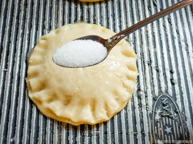 Sprinkling pies with sugar
