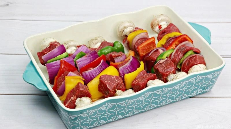 raw, prepped, Steak kebabs in a dish