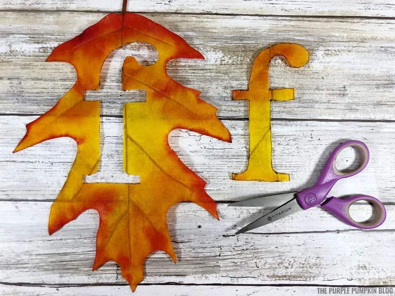 Cutting letter f from autumn leaves