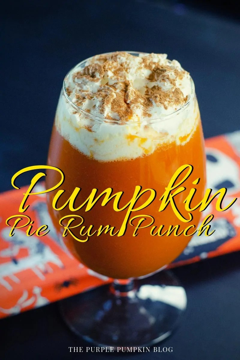Pumpkin Pie Rum Punch with whipped cream and spices topping