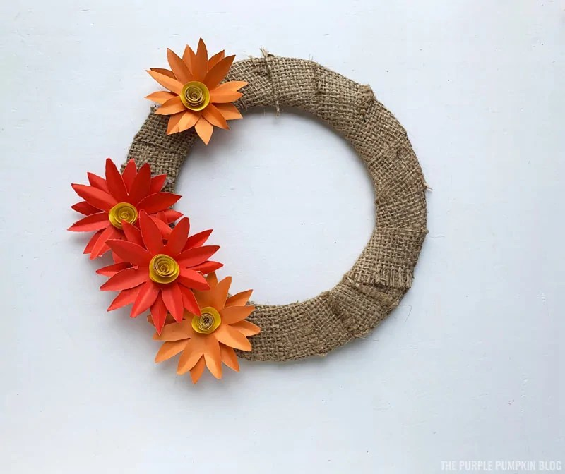 Layout of paper flowers of fall wreath