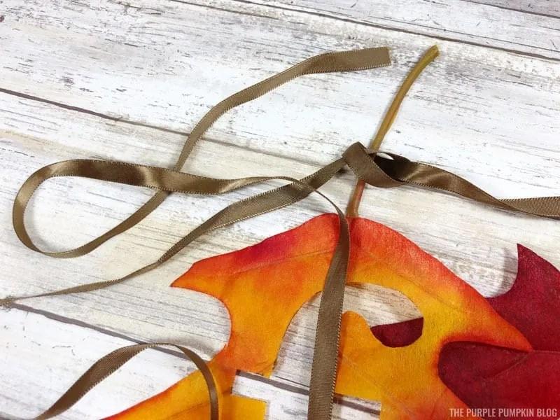 Tying Ribbon to Leaf Stem