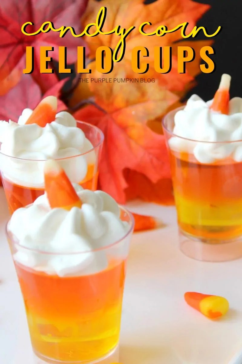 3 candy corn jello cups with fall leaves in the background