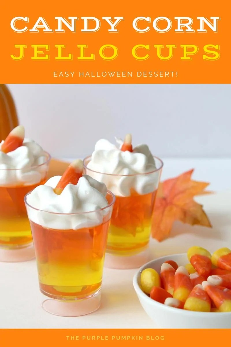 small shot glasses filled with yellow and orange jello and topped with whipped cream and candy corn piece