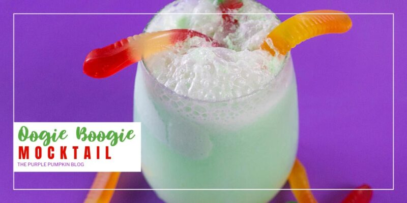 Throw the dice and take a gamble with this Oogie Boogie Mocktail! It is a fizzy, gummy worm-filled drink that is perfect for Halloween! It's so easy and fun to make, and the addition of gummy worms gives it just the right amount of grossness that kids love! Make individual glasses of this Halloween mocktail, or make a large batch and fill up a cauldron with the green bubbling liquid for your own Oogie Boogie Bash! #OogieBoogieMocktail #ThePurplePumpkinBlog #HalloweenMocktails #Mocktails