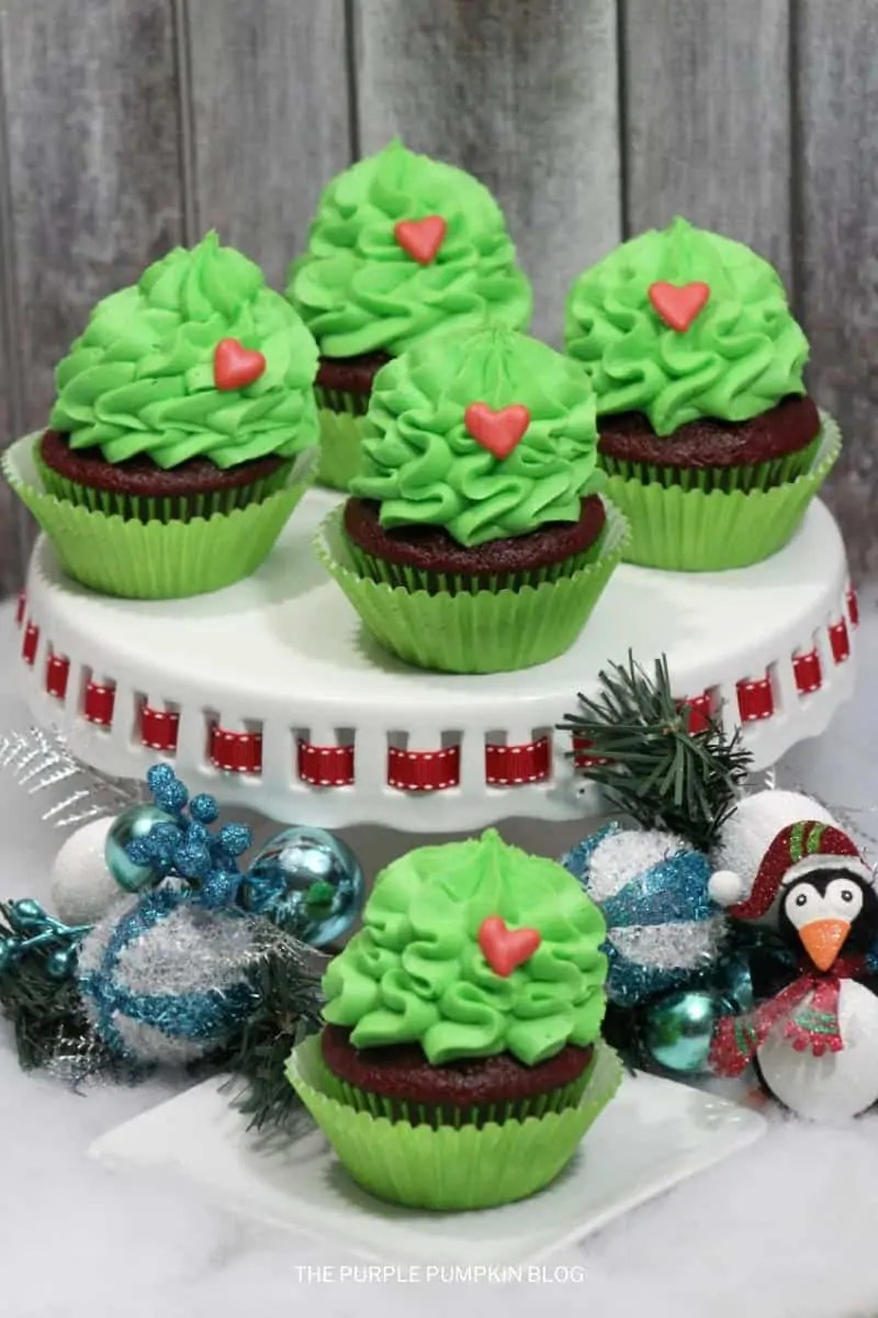 A cake platter of Grinch Cupcakes