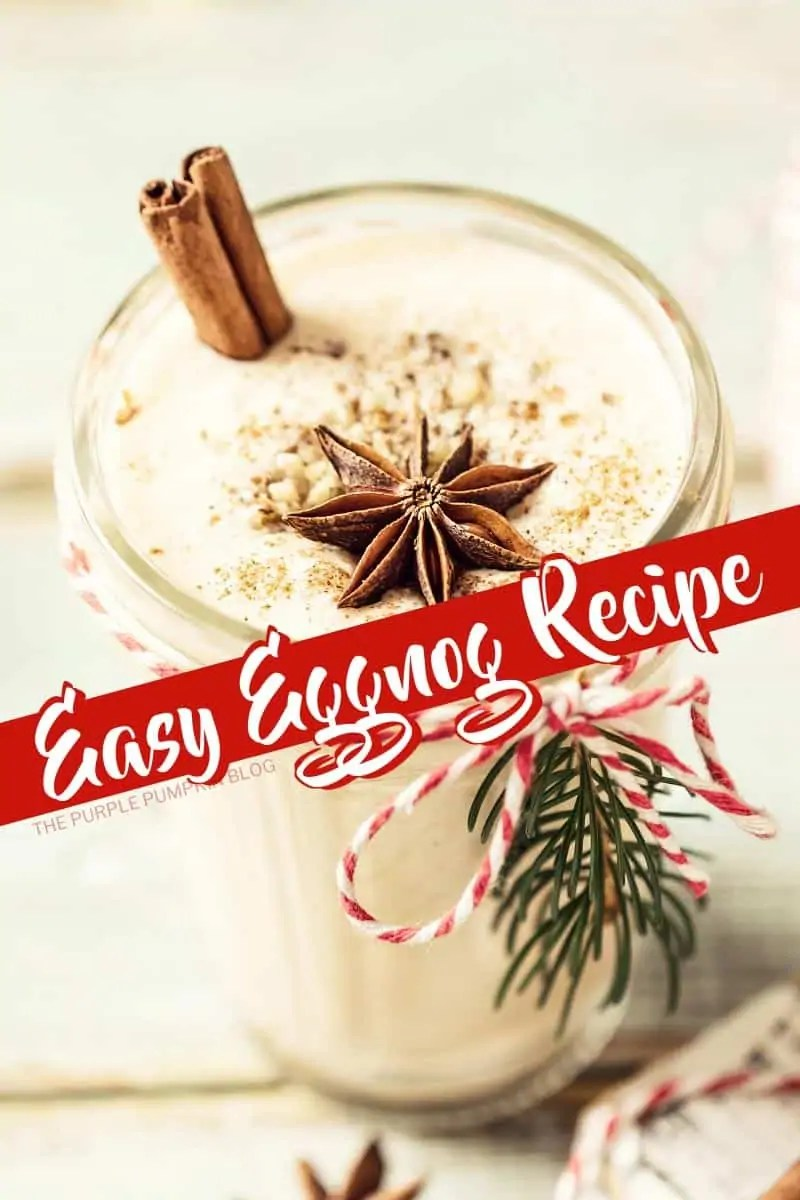 A glass of eggnog with a cinnamon stick and star anise on top