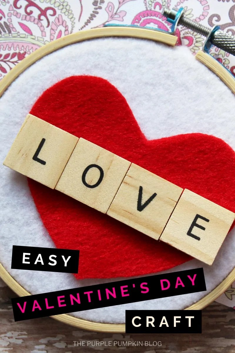 Easy Valentine's Day Craft - Embroidery hoop with white felt background and a red felt heart attached, followed by Scrabble tiles spelling out the word LOVE.