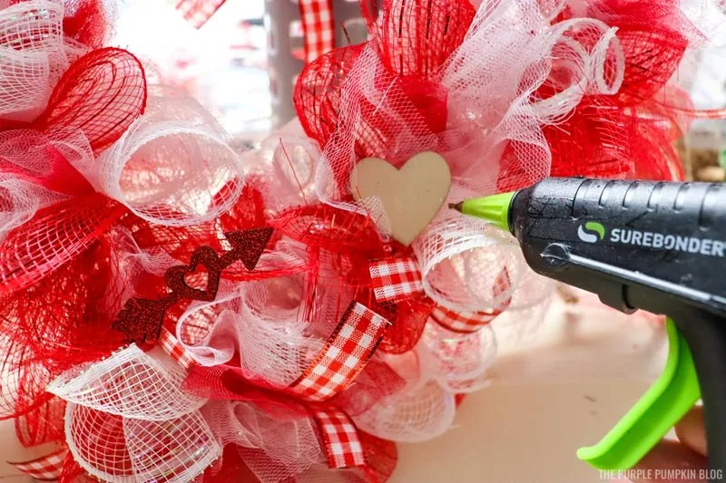 Using Hot Glue Gun To Attach Wooden Hearts