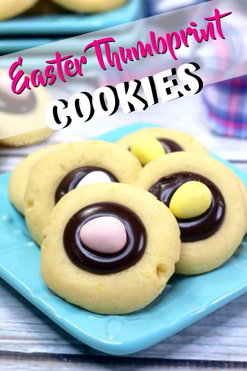 Easter Thumbprint Cookies: Round vanilla cookies filled with chocolate ganache and topped with a candy mini egg. Cookies are stacked onto a blue plate on a wooden table. Photos of the same cookies throughout from a variety of angles with different text overlay unless otherwise described.