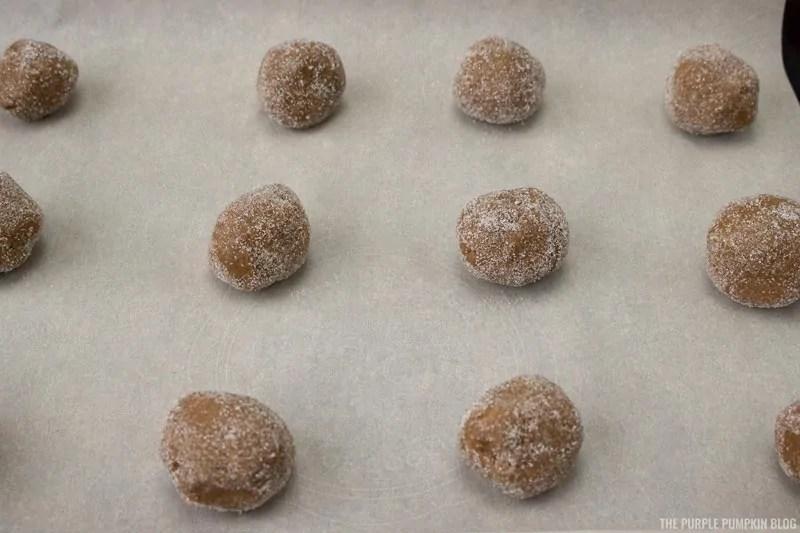 cookie balls on baking sheet
